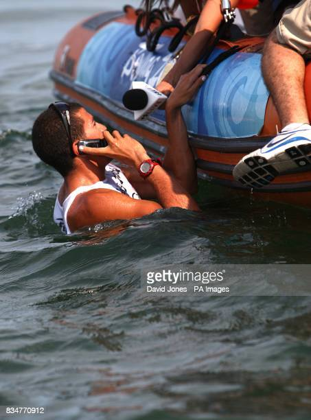 Israel's Shahar Zubari is interviewd whilst on the phone in the water after he wins Bronze after the final round of his RSX Sailing Competition at...