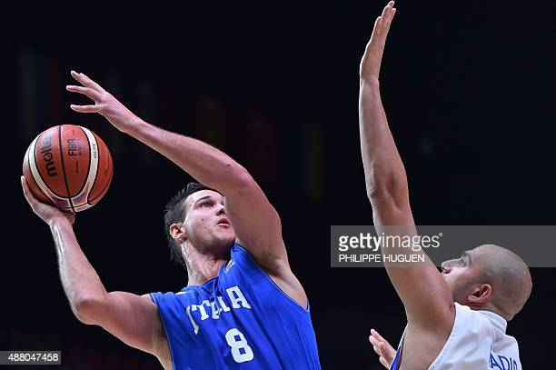 Israel's small forward Elishay Kadir defends against Italy's small forward Danilo Gallinari during the round of 16 basketball match between Israel...