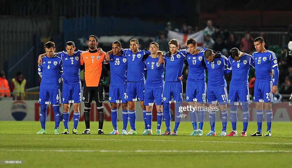 Israel's team line up for a minute's silence before the FIFA 2014 World Cup qualifying football match between Northern Ireland and Israel at Windsor Park in Belfast, Northern Ireland on March 26, 2013. Israel won the game 2-0.