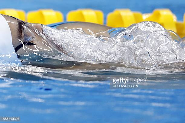 Israel's Yakov Toumarkin competes in a Men's 200m Backstroke heat during the swimming event at the Rio 2016 Olympic Games at the Olympic Aquatics...