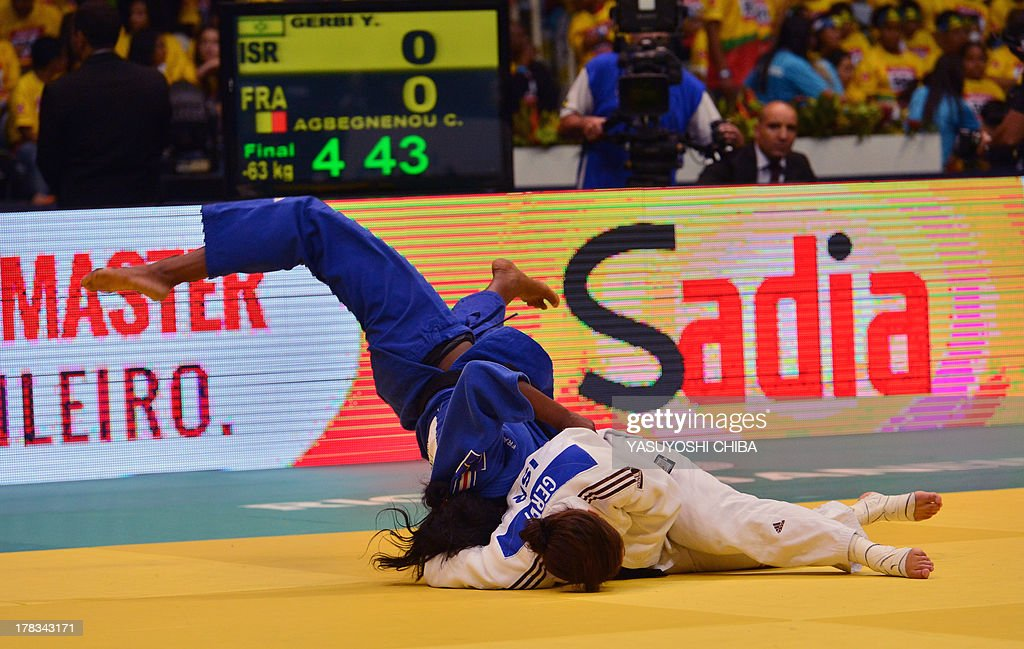 Israel's Yarden Gerbi (R) and France's Clarisse Agbegnenou compete in the women's -63kg category final, during the IJF World Judo Championship, in Rio de Janeiro, Brazil, on August 29, 2013.