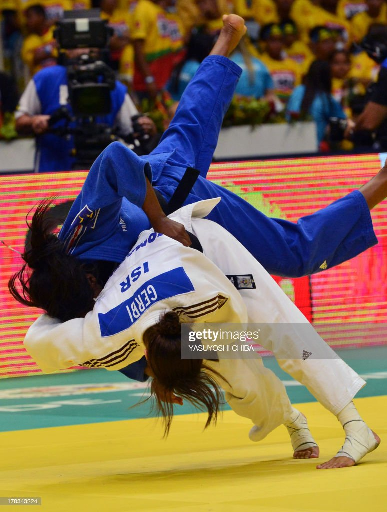 Israel's Yarden Gerbi (bottom) and France's Clarisse Agbegnenou compete in the women's -63kg category final, during the IJF World Judo Championship, in Rio de Janeiro, Brazil, on August 29, 2013. AFP PHOTO / YASUYOSHI CHIBA