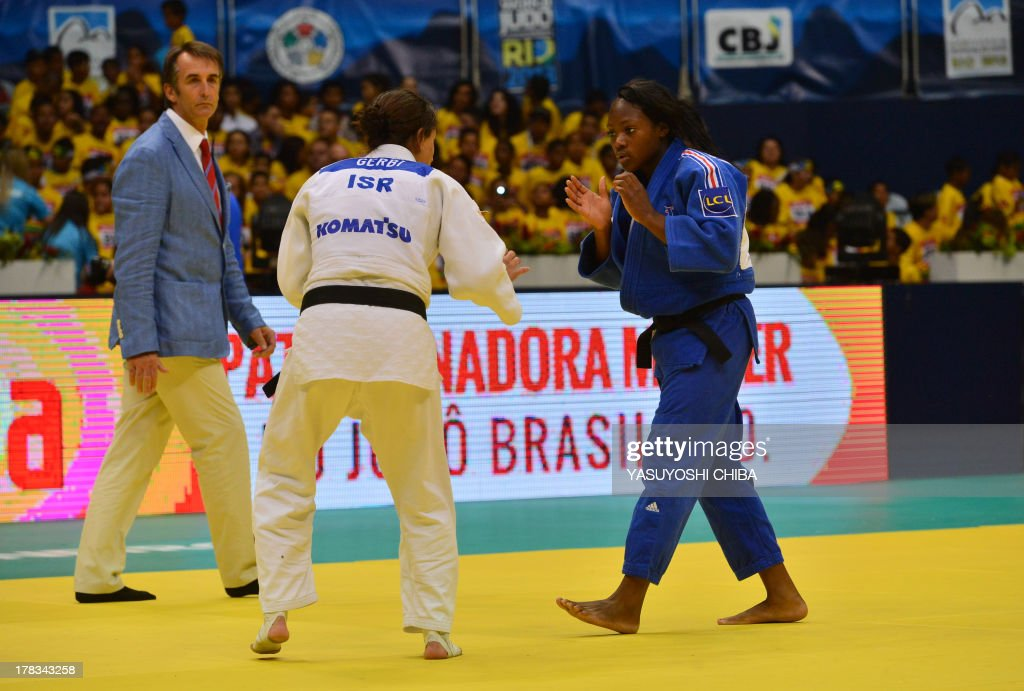 Israel's Yarden Gerbi (L) and France's Clarisse Agbegnenou compete in the women's -63kg category final, during the IJF World Judo Championship, in Rio de Janeiro, Brazil, on August 29, 2013.