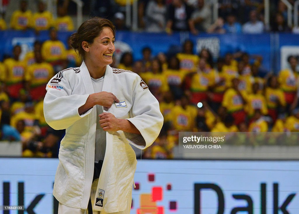 Israel's Yarden Gerbi celebrates after defeating France's Clarisse Agbegnenou in the women's -63kg category final, during the IJF World Judo Championship, in Rio de Janeiro, Brazil, on August 29, 2013.