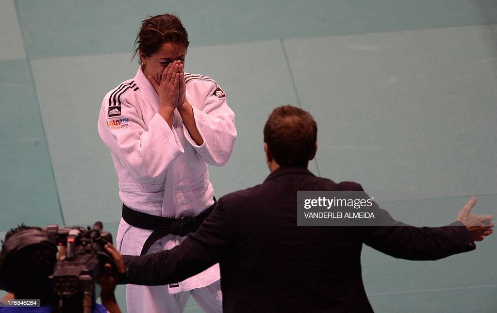 Israel's Yarden Gerbi(white) celebrates after defeating France's Clarisse Agbegnenou in the women's 63kg category final of the IJF World Judo Championship in Rio de Janeiro, Brazil, on August 29, 2013. AFP PHOTO / VANDERLEI ALMEIDA