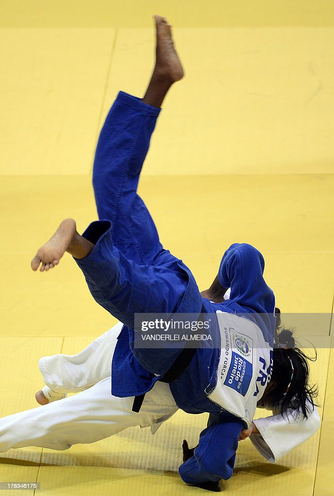 Israel's Yarden Gerbi(white) competes with Clarisse Agbegnenou in the women's 63kg category final of the IJF World Judo Championship in Rio de Janeiro, Brazil, on August 29, 2013.
