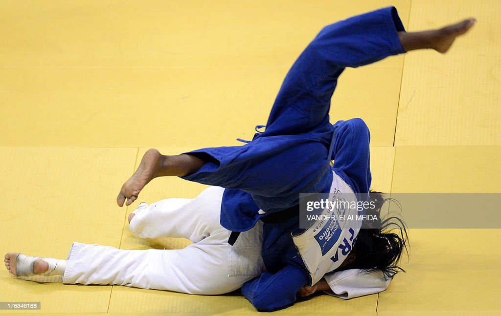 Israel's Yarden Gerbi(white) competes with Clarisse Agbegnenou in the women's 63kg category final of the IJF World Judo Championship in Rio de Janeiro, Brazil, on August 29, 2013. AFP PHOTO / VANDERLEI ALMEIDA