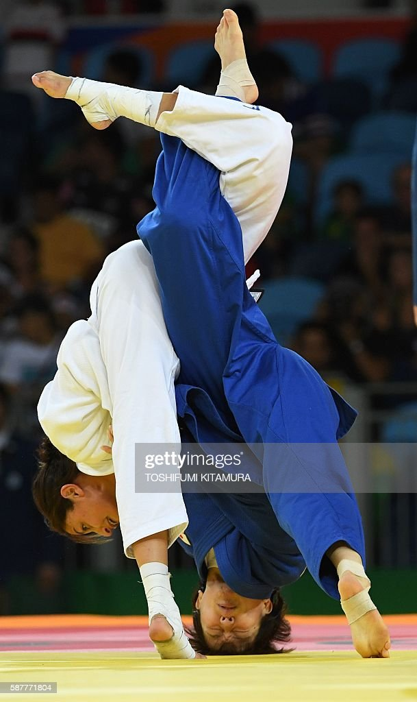 TOPSHOT Israel's Yarden Gerbi competes with Japan's Miku Tashiro during their women's 63kg judo contest bronze medal A match of the Rio 2016 Olympic...