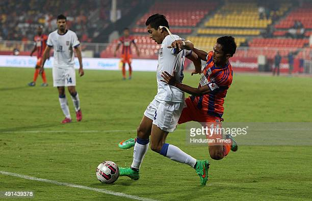 Israil Gurung of FC Pune City trying to go past Mumbai City FC defender Keegan during the Indian Super League match between FC Pune City and Mumbai...