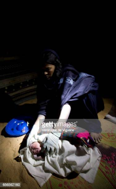 Issa a retrained traditional midwife takes care of the healthy little baby girl that has just been born at 0300am in the morning after 15 hours of...