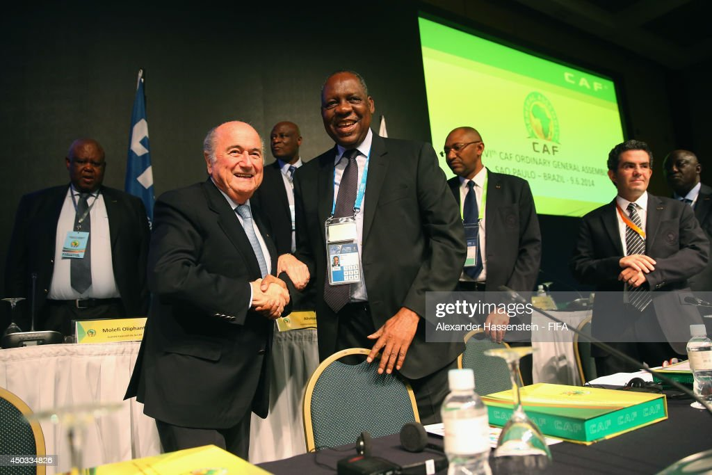 Issa Hayatou (R), President of the CAF welcomes FIFA President Joseph S. Blatter for the CAF confederation congress at Sheraton Sao Paulo WTC hotel on June 9, 2014 in Sao Paulo, Brazil.