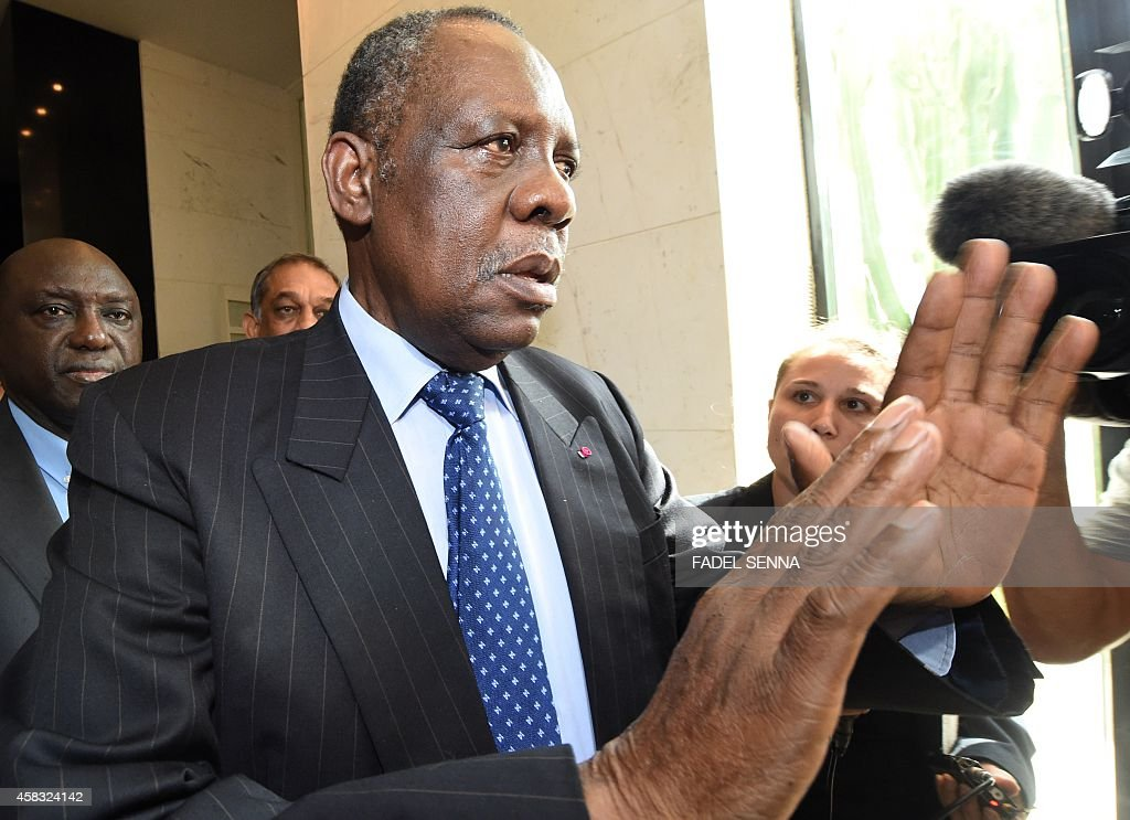 Issa Hayatou president of the Confederation of African Football leaves his hotel on November 3 2014 in Rabat ahead of his meeting to discuss Rabat's...