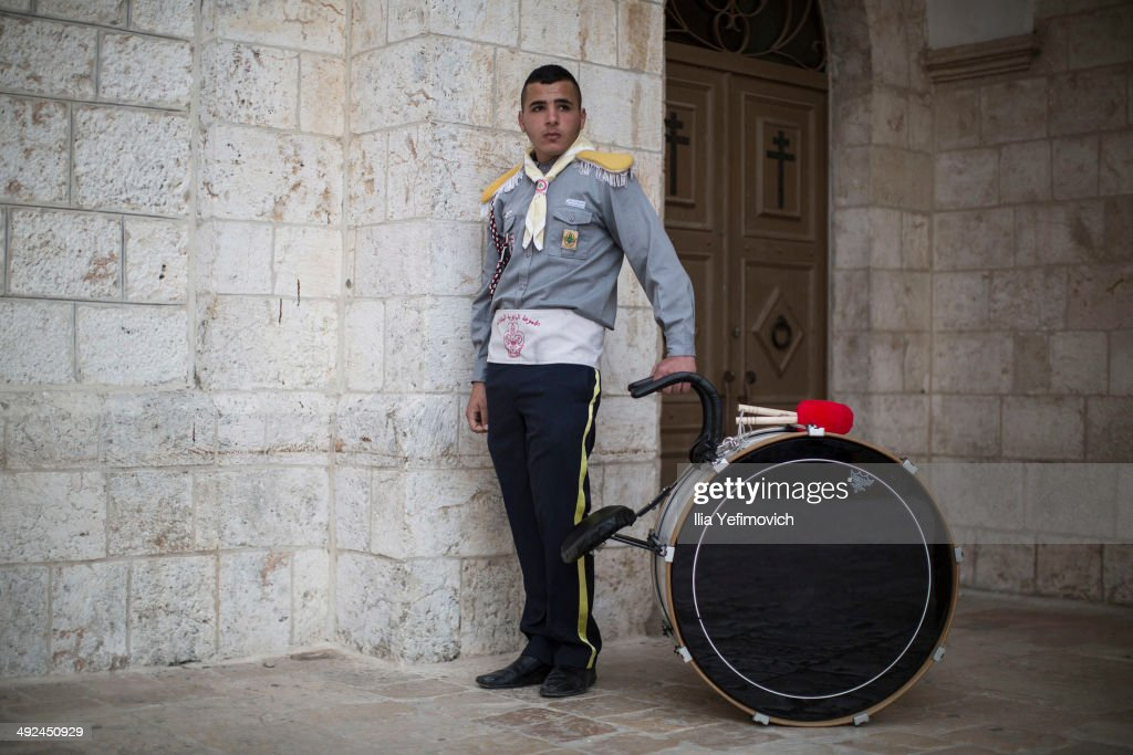 Issa K. Abuhadba of the Latin Christian church scout brigade poses for a portrait outside the church on May 20, 2014 in Bethlehem, West Bank. The scouts will act as ushers when Pope Francis makes his first visit to the Holy Land as pontiff to both the West Bank and Israel this coming Sunday. The Pope will celebrate two public Masses during his visit, one in Amman, Jordan and the other in Manger Square in Bethlehem.