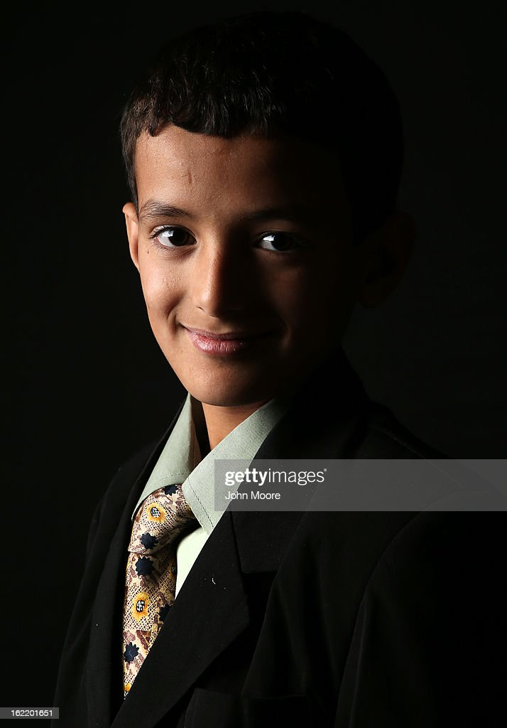 Issa Nasher, 12, who's family immigrated from Yemen to Newburgh, NY, awaits his American citizenship certificate at the U.S. Citizenship and Immigration Services (USCIS), office on February 19, 2013 in New York City. Almost 300 foreign-born children of naturalized immigrants received citizenship certificates Tuesday at the center during the special event. Children of naturalized immigrants receive U.S. citizenship if they arrive to the United States as minors, but they must go through a process at USCIS to receive official citizenship documents proving they have become Americans.