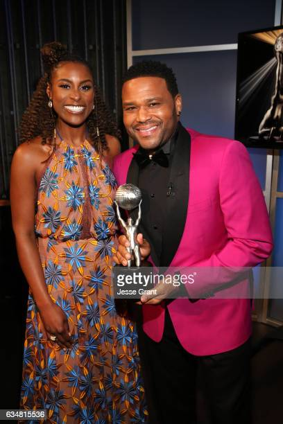 Issa Rae and host Anthony Anderson attend the 48th NAACP Image Awards at Pasadena Civic Auditorium on February 11 2017 in Pasadena California