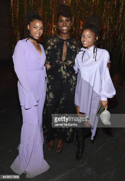 Issa Rae poses with RB duo Chloe X Halle at the Refinery29 Third Annual 29Rooms Turn It Into Art event on September 7 2017 in the Brooklyn borough of...