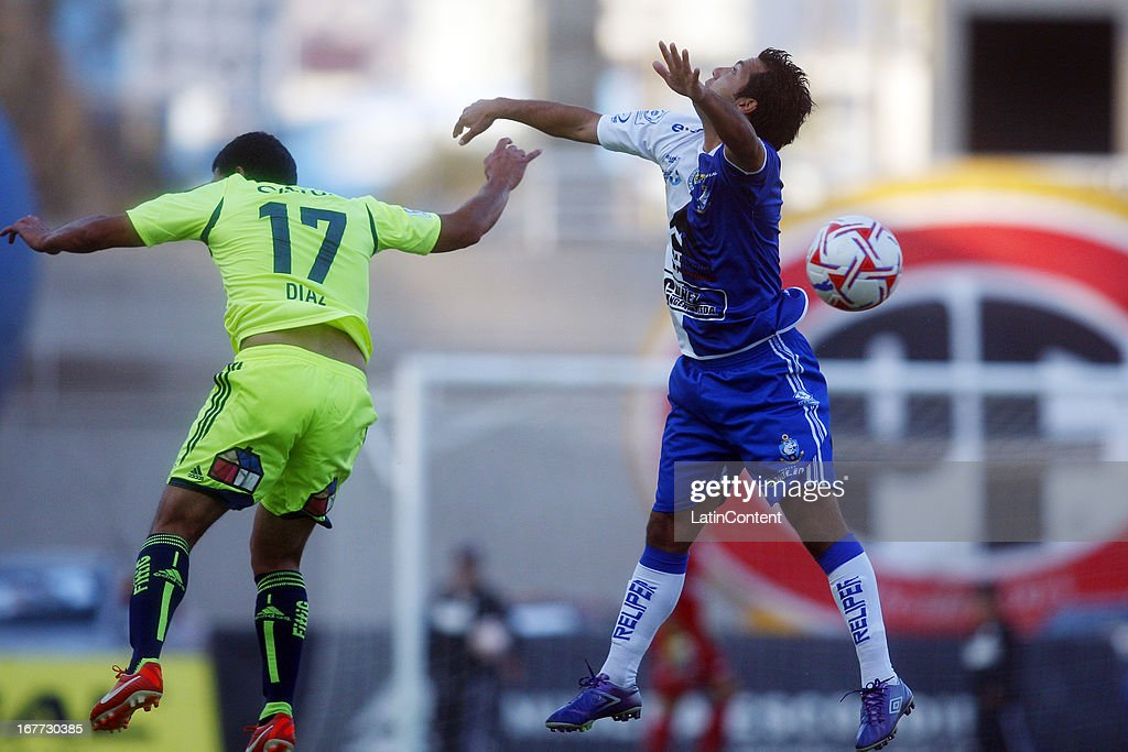 Issac Díaz of Universidad de Chile, struggles for the ball with Victor Oyarzún of Antofagasta during a match between Antofagasta and Universidad de Chile as part of Torneo Descentralizado 2013 at Bicentenario Calvo y Bascunan stadium on April 28, 2013 in Antofagasta, Chile.
