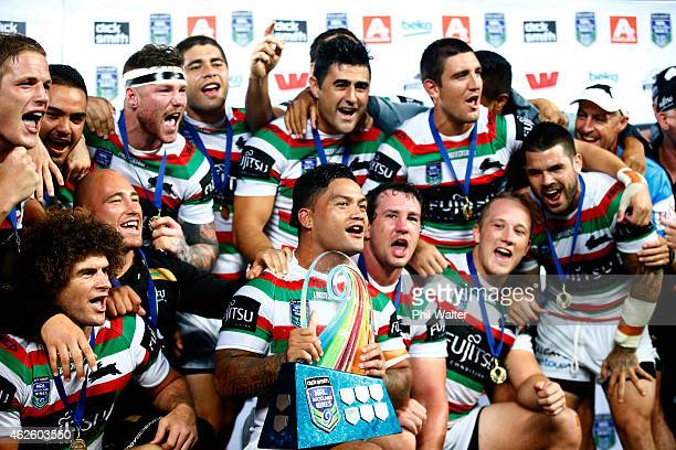 Issac Luke and the Rabbitohs celebrate with the trophy following during the grand final match between the South Sydney Rabbitohs and the...