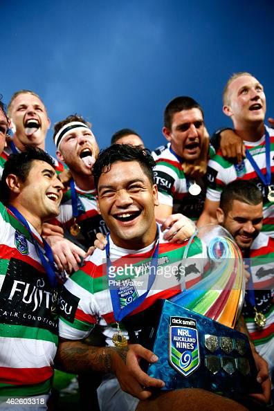 Issac Luke of the Rabbitohs celebrates with the trophy following during the grand final match between the South Sydney Rabbitohs and the...