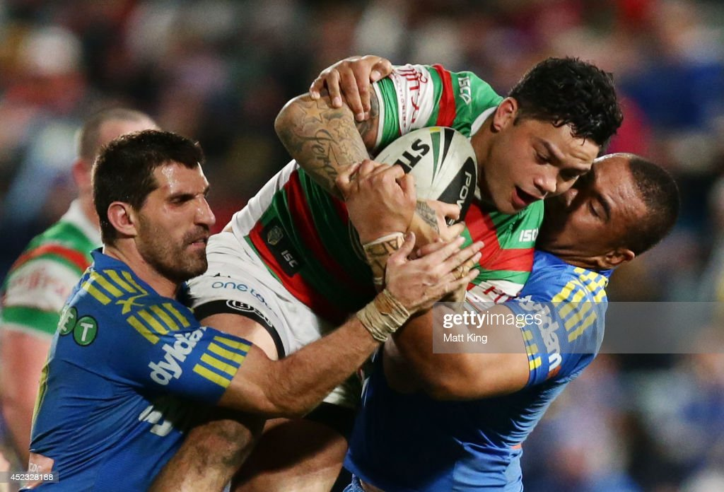 <a gi-track='captionPersonalityLinkClicked' href=/galleries/search?phrase=Issac+Luke&family=editorial&specificpeople=5082833 ng-click='$event.stopPropagation()'>Issac Luke</a> of the Rabbitohs is tackled during the round 19 NRL match between the Parramatta Eels and the South Sydney Rabbitohs at Pirtek Stadium on July 18, 2014 in Sydney, Australia.
