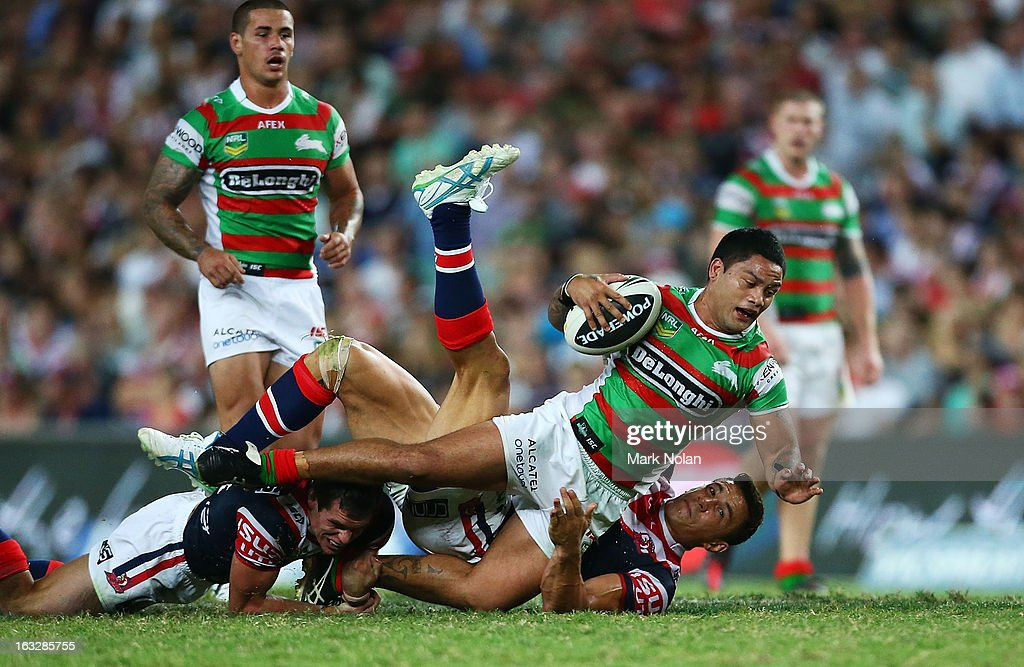 Issac Luke of the Rabbitohs is tackled during the round one NRL match between the Sydney Roosters and the South Sydney Rabbitohs at Allianz Stadium on March 7, 2013 in Sydney, Australia.