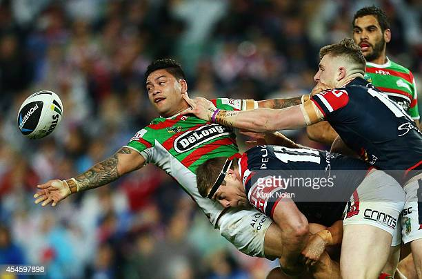 Issac Luke of the Rabbitohs offloads during the round 26 NRL match between the Sydney Roosters and the South Sydney Rabbitohs at Allianz Stadium on...