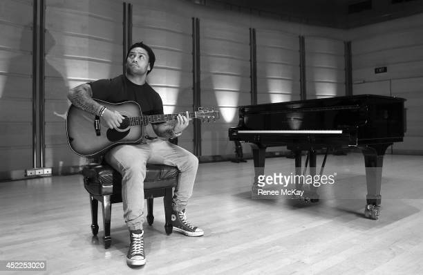 Issac Luke of the South Sydney Rabbitohs poses during a portrait session at City Recital Hall on July 16 2014 in Sydney Australia