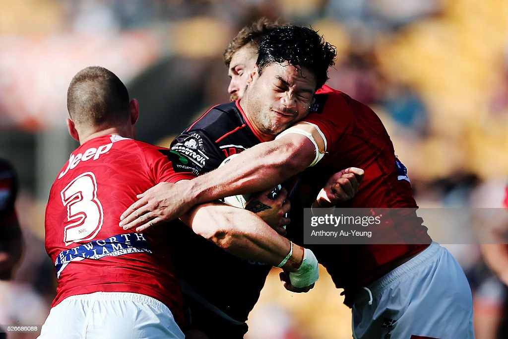 Issac Luke of the Warriors charges into Euan Aitken of the Dragons during the round nine NRL match between the New Zealand Warriors and the St George Illawarra Dragons at Mt Smart Stadium on May 1, 2016 in Auckland, New Zealand.
