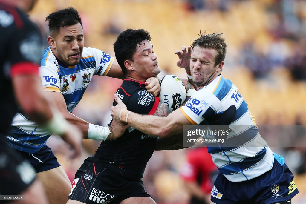 Issac Luke of the Warriors charges into Kane Elgey of the Titans during the round five NRL match between the New Zealand Warriors and the Gold Coast Titans at Mt Smart Stadium on April 2, 2017 in Auckland, New Zealand.