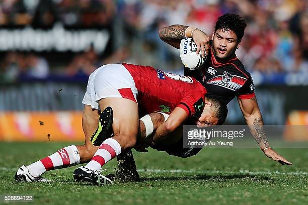 Issac Luke of the Warriors is tackled by Benji Marshall of the Dragons during the round nine NRL match between the New Zealand Warriors and the St...