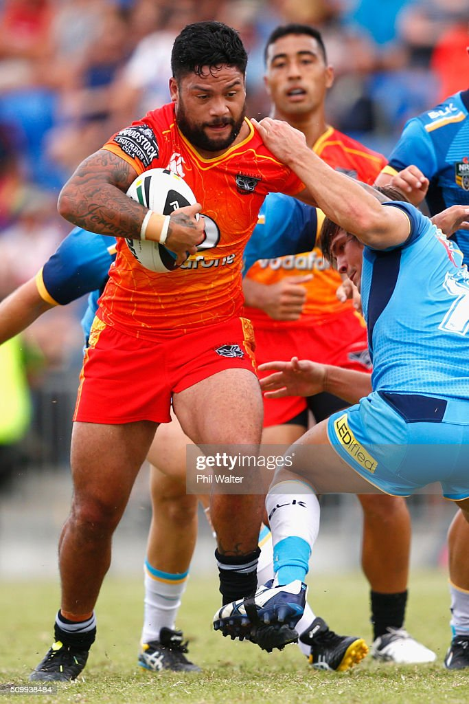 Issac Luke of the Warriors is tackled during the NRL Trial Match between the New Zealand Warriors and the Gold Coast Titans at Toll Stadium on February 13, 2016 in Whangarei, New Zealand.