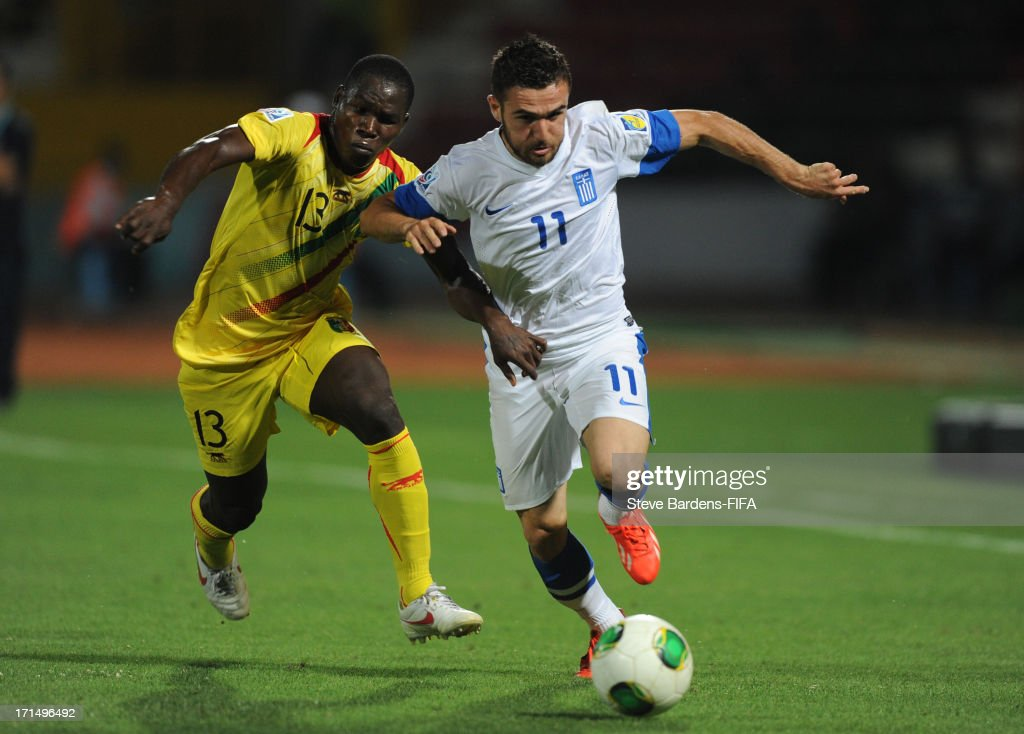 Issaka Samake of Mali challenges for the ball with Ioannis Gianniotas (R) of Greece during the FIFA U20 World Cup Group D match between Mali and Greece at Kamil Ocak Stadium on June 25, 2013 in Gaziantep, Turkey.