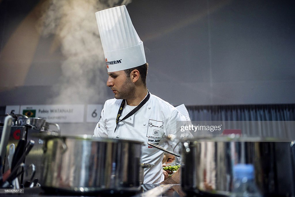 Issam Jaafari of Morocco competes in the 14thworld final of the international culinary competition of the Bocuse d'Or (Golden Bocuse), on January 29, 2013 in Chassieu, central eastern France. AFP PHOTO / JEFF PACHOUD