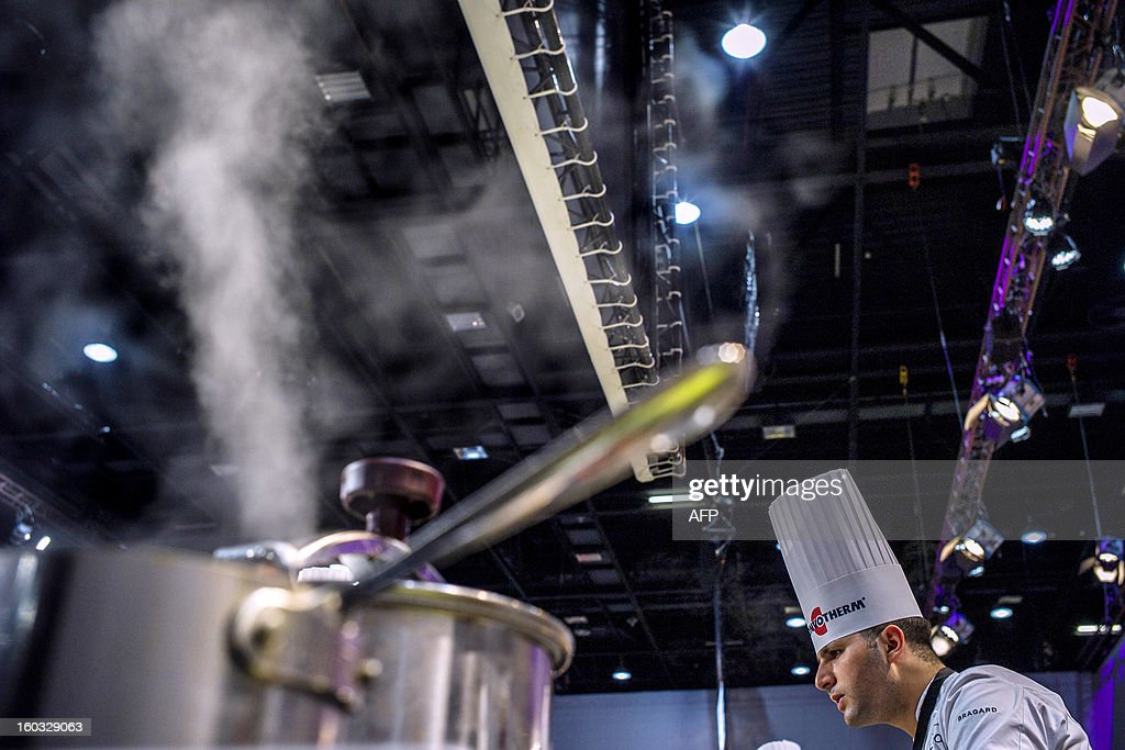 Issam Jaafari of Morroco competes in the 14th world final of the international culinary competition of the Bocuse d'Or (Golden Bocuse), on January 29, 2013 in Chassieu, central eastern France. AFP PHOTO / JEFF PACHOUD