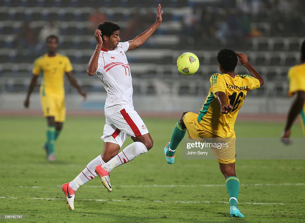 Issam Jemaa (L) of Tunisia in action during the international friendly game between Tunisia and Ethiopia at the Al Wakrah Stadium on January 7, 2013 in Doha, Qatar.