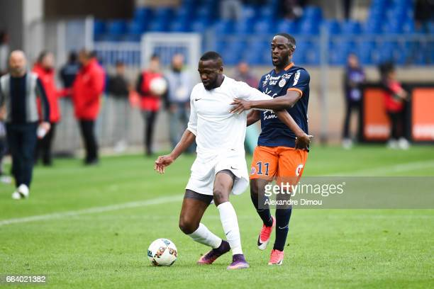 Issiaga Sylla of Toulouse and Jonathan Ikone of Montpellier during the French Ligue 1 match between Montpellier and Toulouse at Stade de la Mosson on...