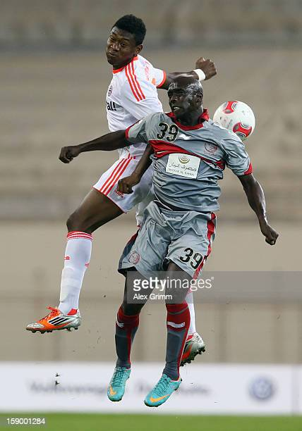 Issiar Dia of Lekhwiya jumps for a header with David Alaba of Muenchen during the international friendly match between Lekhwiya Sports Club and FC...