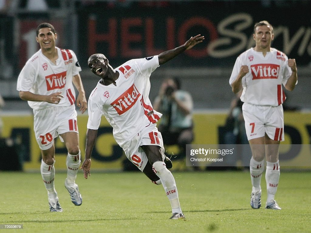 Issiar Dia of Nancy celebrates the third goal during the UEFA Cup second leg match between AS Nancy and Schalke 04 at the Marcel Picot Stadium on...