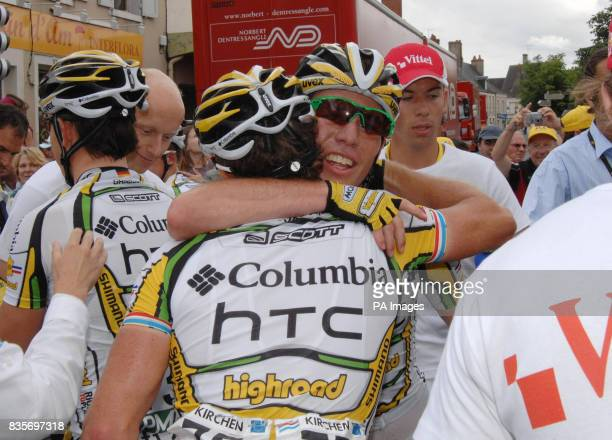 Issoudun Team mate Kim Kirchen congratulates Mark Cavendish on the finish line of the 10th stage in France