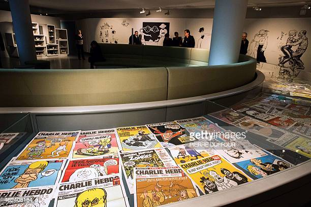 Issues of French satirical weekly Charlie Hebdo are displayed during the exhibition 'Une histoire de Charlie hebdo' in tribute to the French...