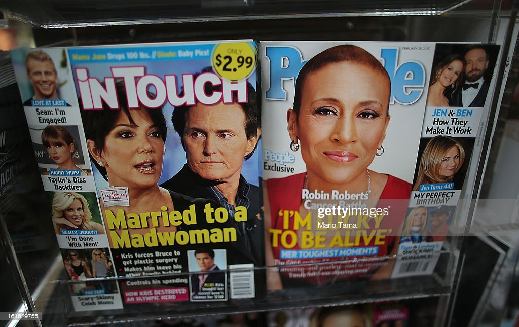 Issues of People magazine (R) are displayed at a newsstand in Manhattan on February 13, 2013 in New York City. Time Warner Inc. is reportedly in talks to sell most of its magazine group, including People, InStyle and Entertainment Weekly, to the Meredith Corporation. Time Warner would reportedly retain control of flagship titles Time, Sports Illustrated and Fortune.