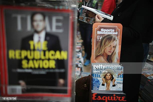 Issues of Time and Sports Illustrated magazines are displayed at a newsstand in Manhattan on February 13 2013 in New York City Time Warner Inc is...