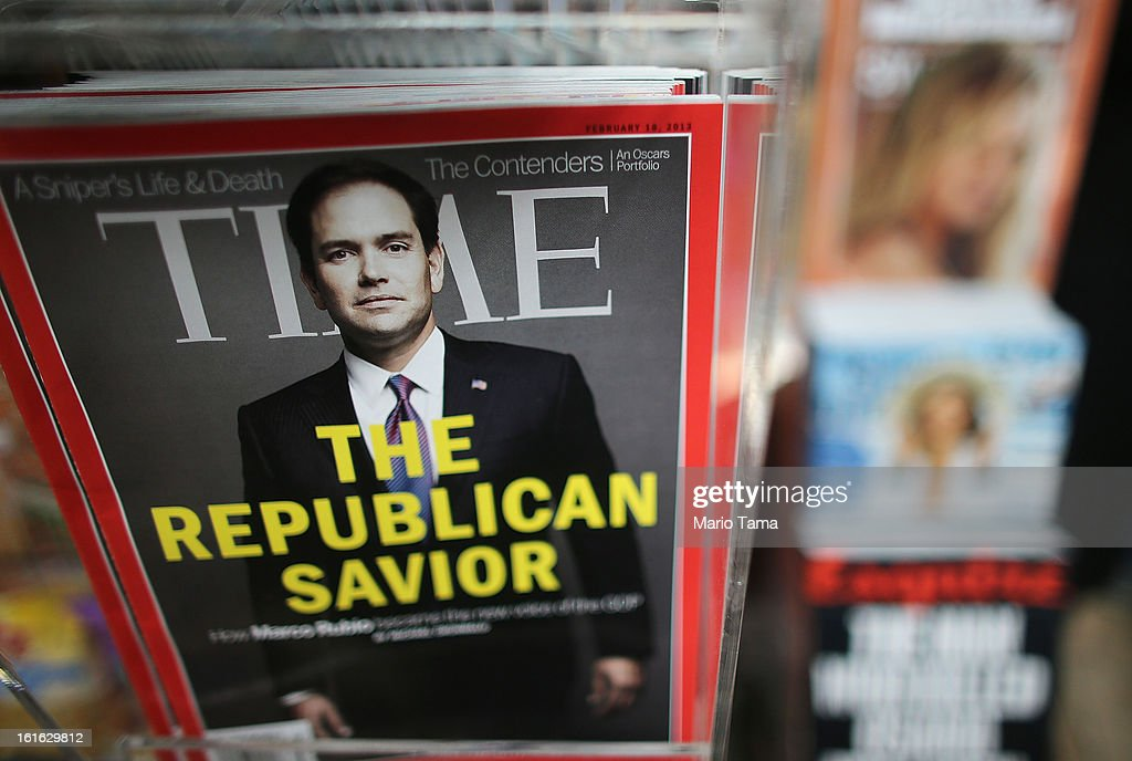 Issues of Time magazine are for sale at a newsstand in Manhattan on February 13, 2013 in New York City. Time Warner Inc. is reportedly in talks to sell most of its magazine group, including People, InStyle and Entertainment Weekly, to the Meredith Corporation. Time Warner would reportedly retain control of flagship titles Time, Sports Illustrated and Fortune.
