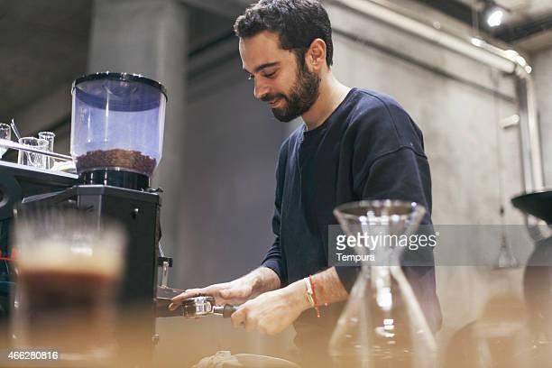 Istanbul barista attending coffee maker.