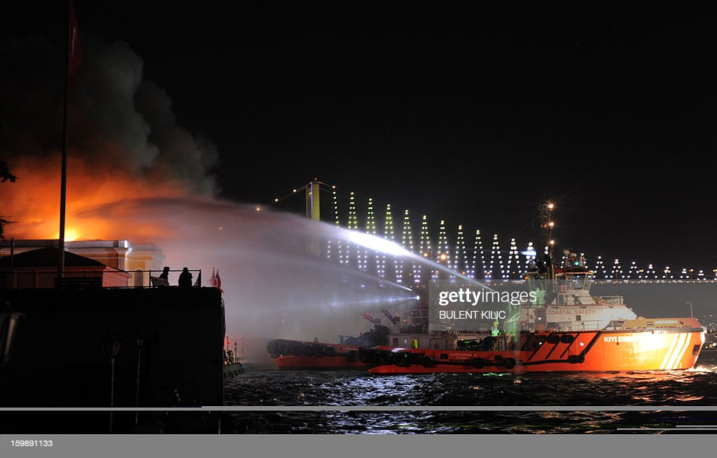 Istanbul fireteams try to control flames at Galatasaray University on January 22, 2013, in Istanbul. AFP PHOTO/BULENT KILIC