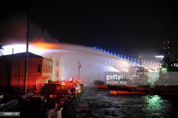 Istanbul fireteams try to control flames at Galatasaray University on January 22 in Istanbul AFP PHOTO/BULENT KILIC