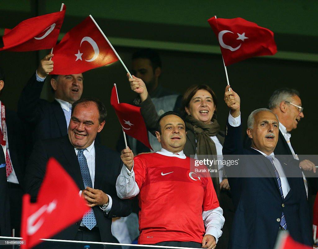 Istanbul Governor Huseyin Avni Mutlu (R), Turkey's European Affairs minister Egemen Bagis (2nd R), Turkish Football Federation chief Yildirim Demiroren (2nd L) and First Vice-President of UEFA Senes Erzik (L) wave Turkish flags during FIFA 2014 World Cup Qualifier match at the Sukru Saracoglu Stadium on October 15, 2013 in Istanbul, Turkey.