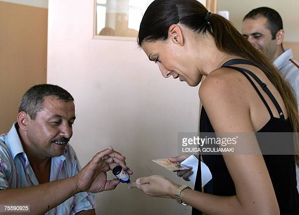 A Turkish woman gets her finger marked after casting her vote for Turkey's general elections in a polling station in Istanbul 22 July 2007 Turkish...