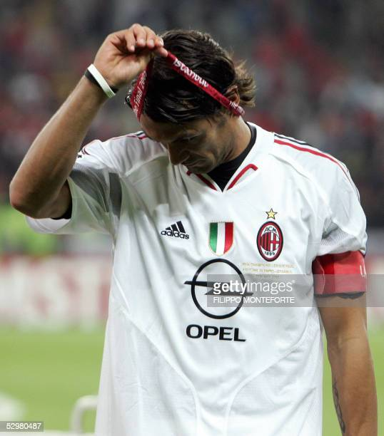AC Milan's Italian captain and defender Paolo Maldini takes off his medal at the end of the UEFA Champions league football final AC Milan vs...