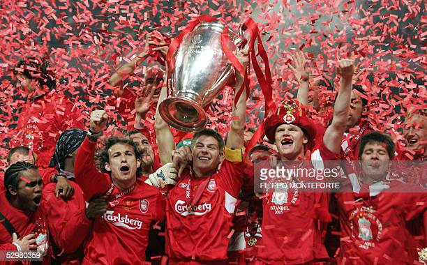 Liverpool's captain Steven Gerrard holds the throphy surrounded by teammates at the end of the UEFA Champions league football final AC Milan vs...